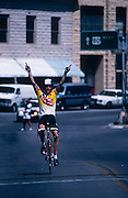 Cyclist flashes victory sign, La Vuelta de Bisbee, Bisbee, Arizona..Subject photograph(s) are copyright Edward McCain. All rights are reserved except those specifically granted by Edward McCain in writing prior to publication...McCain Photography.211 S 4th Avenue.Tucson, AZ 85701-2103.(520) 623-1998.mobile: (520) 990-0999.fax: (520) 623-1190.http://www.mccainphoto.com.edward@mccainphoto.com