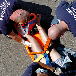 Kyle Green | The Roanoke Times<br /> June 27, 2005 Roanoke Fire EMS tend to a person who allegedly jumped off of the Elm Street bridge onto 581 North on Monday afternoon. The man was transported alive from the scene in an ambulance.