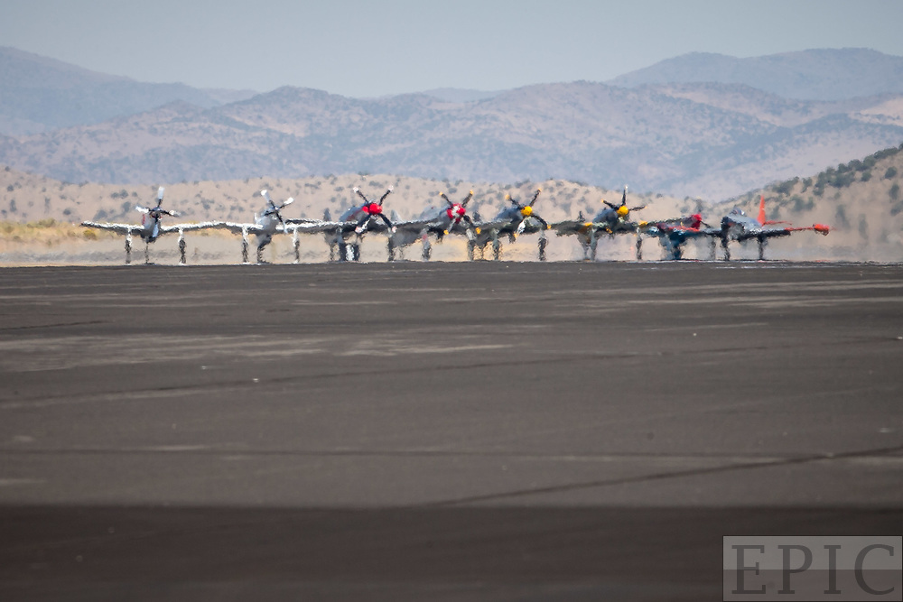 RENO, NV - SEPTEMBER 17: Unlimited class airplanes wait at the end of the runway before beginning their race at the Reno Championship Air Races on September 17, 2017 in Reno, Nevada. (Photo by Jonathan Devich/Getty Images) *** Local Caption ***