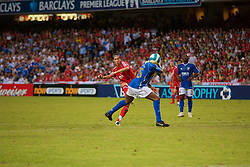 Hong Kong, China - Friday, July 27, 2007: Liverpool's Fernando Torres bends the ball around Portsmouth's Sylvain Distin and narrowly over the bar during the final of the Barclays Asia Trophy at the Hong Kong Stadium. (Photo by David Rawcliffe/Propaganda)