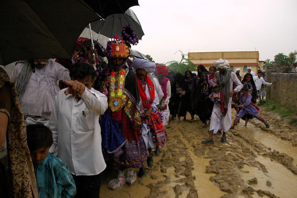 A muddy wedding procession...by Michael Benanav - mbenanav@gmail.com