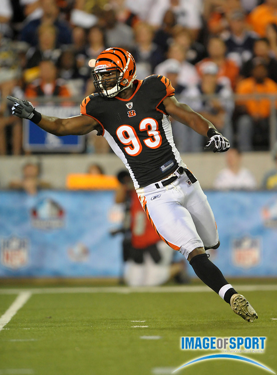 Aug 8, 2010; Canton, OH, USA; Cincinnati Bengals linebacker Michael Johnson (93) reacts during the preseason game against the Dallas Cowboys at Fawcett Stadium. The Cowboys defeated the Bengals 16-7. Photo by Image of Sport
