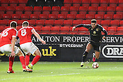 Milton Keynes Dons striker Kieran Agard (14) taking on two Charlton players during the The FA Cup match between Charlton Athletic and Milton Keynes Dons at The Valley, London, England on 3 December 2016. Photo by Matthew Redman.