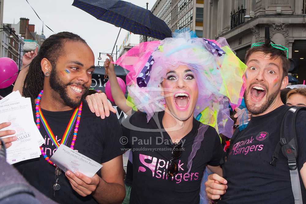 London, June 28th 2014. High spirits as as the Pride London parade proceeds through the city's streets.