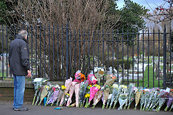 © Licensed to London News Pictures. 29/01/2018. London, UK.  A man views floral tributes laid out at the site of a car crash where three teenage boys were killed in Hayes, west London, on the night of 27 January.  Jaynesh Chudasama, 28, of Hayes has been charged with three counts of causing death by dangerous driving and will appear in custody at Uxbridge Magistrates Court on Monday 29 January.  Photo credit: Stephen Chung/LNP