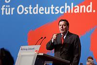 """10 MAR 2002, MAGDEBURG/GERMANY:<br /> Gerhard Schroeder, SPD, Bundeskanzler, waehrend seiner Rede, gemeinsamer Parteitag der ostdeutschen SPD Landesverbaende unter dem Motto:""""Richtung Zukunft. Politik fuer Ostdeutschland."""", Hotel Maritim<br /> IMAGE: 20020310-01-026<br /> KEYWORDS: Party congress, Gerhard Schröder"""