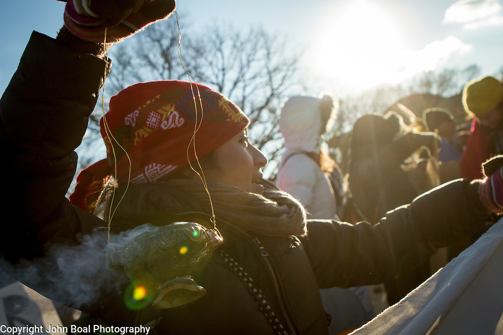 Protest and march from in front of the U.S. Capitol to the EPA, about the North Dakota Access Pipeline, as well as the effort to free Leonard Peltier.  Saturday, December 10, 2016. John Boal PhotographyJuanita Cabrera Lopez, Maya, carries an incense burner with Pom, or Copal tree resin, during a protest and march from in front of the U.S. Capitol to the EPA, about the North Dakota Access Pipeline, as well as the effort to free Leonard Peltier.  Saturday, December 10, 2016. John Boal Photography