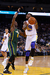 Feb 2, 2012; Oakland, CA, USA; Golden State Warriors small forward Dorell Wright (1) shoots past Utah Jazz small forward Josh Howard (8) during the first quarter at Oracle Arena. Mandatory Credit: Jason O. Watson-US PRESSWIRE