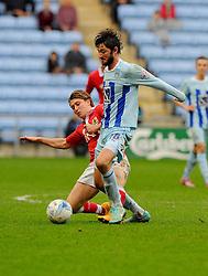 Bristol City's Luke Freeman battles for the ball with Coventry City's Adam Barton  - Photo mandatory by-line: Joe Meredith/JMP - Mobile: 07966 386802 - 18/10/2014 - SPORT - Football - Coventry - Ricoh Arena - Bristol City v Coventry City - Sky Bet League One
