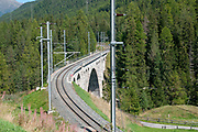 Railway tracks over a stone bridge, in the Swiss Alps near Brail in the Maloja Region in the Swiss canton of Graubünden. in the Inn Valley