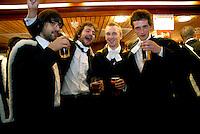 Graduating Students drinking at the bar Cambridge University Graduation Day 2007.
