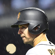 NEW YORK, NEW YORK - APRIL 29:  Buster Posey #28 of the San Francisco Giants waiting to bat in the rain during the New York Mets Vs San Francisco Giants MLB regular season game at Citi Field on April 29, 2016 in New York City. (Photo by Tim Clayton/Corbis via Getty Images)
