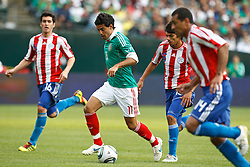 March 26, 2011; Oakland, CA, USA;  Mexico forward Carlos Vela (11) dribbles past Paraguay defender Paulo da Silva (14) and midfielder Marcos Riveros (15) and midfielder Cristian Martinez (16) during the second half at Oakland-Alameda County Coliseum. Mexico defeated Paraguay 3-1.