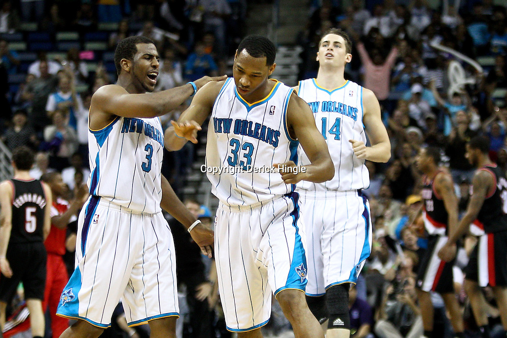 March 30, 2011; New Orleans, LA, USA; New Orleans Hornets shooting guard Willie Green (33) celebrates with point guard Chris Paul (3) after hitting a three point basket during the fourth quarter against the Portland Trail Blazers at the New Orleans Arena. The Hornets defeated the Trail Blazers 95-91.   Mandatory Credit: Derick E. Hingle