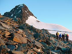 THEMENBILD - Großglockner im Sommer. das Bild wurde am 12. August 2012 aufgenommen. im Bild eine Gruppe von Bergsteigern steigt im ersten Sonnenlicht in Richtung Großglockner auf // THEME IMAGE FEATURE - Großglockner at Summer. The image was taken on august, 12, 2012. Picture shows Group of Alpinists climbing to Grossglockner at the first sunlight of the day, AUT, EXPA Pictures © 2012, PhotoCredit: EXPA/ M. Gruber