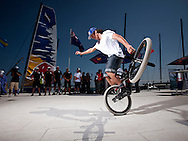 Extreme Sailing Series 2011. Leg 1. Muscat. Oman.Red Bull freestyle BMX rider at The Wave, Muscat