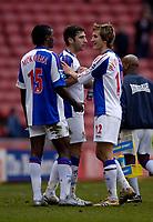Photo: Jed Wee.<br />Sunderland v Blackburn Rovers. The Barclays Premiership. 25/03/2006.<br /><br />Blackburn's Morten Gamst Pedersen (R) celebrates with Zurab Khizanishvilli (C) and Aaron Mokoena at the end of the match.
