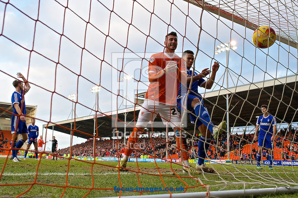 Gary Madine of Blackpool (2nd left) celebrates after Steven Davies of Blackpool scores their third goal to make it Blackpool 3 Nottingham Forest 2 during the Sky Bet Championship match at Bloomfield Road, Blackpool<br /> Picture by Ian Wadkins/Focus Images Ltd +44 7877 568959<br /> 14/02/2015