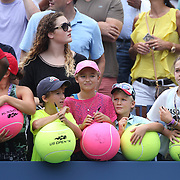 Young fans wait for autographs of Caroline Wozniacki, Denmark, after her victory over Maria Sharapova, Russia, during the US Open Tennis Tournament, Flushing, New York, USA. 31st August 2014. Photo Tim Clayton