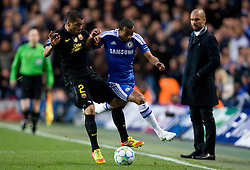 18.04.2012, Stamford Bridge, London, ENG, UEFA CL, Halblfinal-Hinspiel, FC Chelsea (ENG) vs FC Barcelona (ESP), im Bild Chelsea's Ashley Cole vies for the ball with Barcelona's Daniel Alves, left during the UEFA Championsleague Halffinal 1st Leg Match, between FC Chelsea (ENG) and FC Barcelona (ESP), at the Stamford Bridge, London, Great Britain on 2012/04/18. EXPA Pictures © 2012, PhotoCredit: EXPA/ Propagandaphoto/ Tim Hales     / ATTENTION - OUT OF ENG, GBR, UK *****