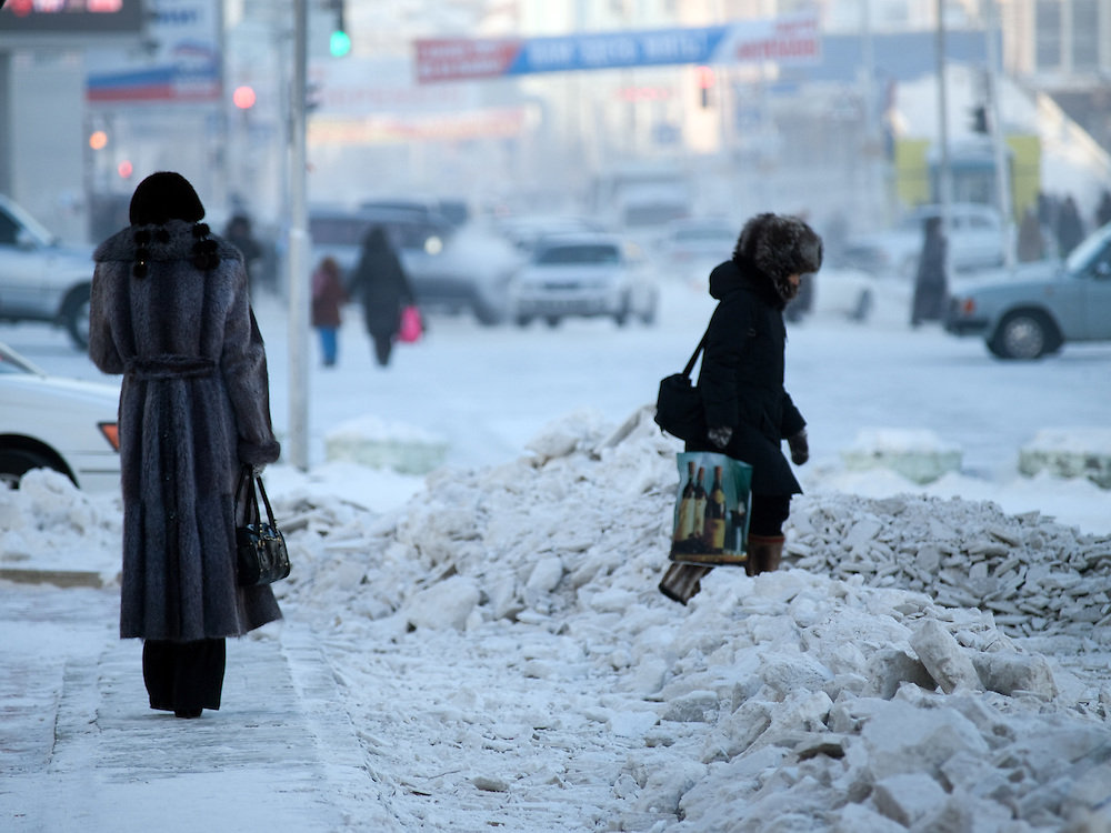 Passersby in the city center of Yakutsk. Yakutsk was founded in 1632 and celebrated 2007 the 375th anniversary. Yakutsk is a city in the Russian Far East, located about 4 degrees (450 km) below the Arctic Circle. It is the capital of the Sakha (Yakutia) Republic (formerly the Yakut Autonomous Soviet Socialist Republic), Russia and a major port on the Lena River. Yakutsk is one of the coldest cities on earth, with winter temperatures averaging -40.9 degrees Celsius.