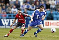 Photo: Olly Greenwood.<br />Gillingham v Swansea City. Coca Cola League 1. 25/03/2006.<br />Gillingham's Matthew Jarvis and Swanseas Leon Britton (L).