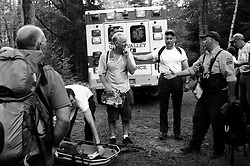 After the two-hour descent from Mount Cube in Orford, N.H., Bob Brownell thanks the group of paramedics, volunteers and hikers who helped his injured wife, including Sgt. Brian Suttmeier of New Hampshire Fish and Game, second from right, and Tom Bourgoine, right, of the Upper Valley Wilderness Response Team. &quot;Bless these folks,&quot; Brownell said of the rescuers.<br /> Valley News - James M. Patterson<br /> jpatterson@vnews.com<br /> photo@vnews.com