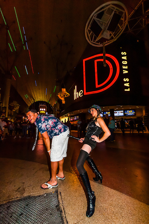 Tourist getting S&M demo, Fremont Street Experience, Downtown Las Vegas, Nevada USA.