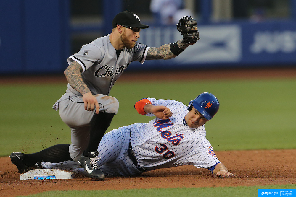 NEW YORK, NEW YORK - May 31:  Michael Conforto #30 of the New York Mets steals second as Brett Lawrie #15 of the Chicago White Sox attempts to tag during the Chicago White Sox  Vs New York Mets regular season MLB game at Citi Field on May 31, 2016 in New York City. (Photo by Tim Clayton/Corbis via Getty Images)