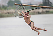 Duck-catching in China<br /> <br /> A competitor tries to slap the pole before catching ducks during a folk activity in celebration of the Dragon Boat Festival on May 30, 2017 in Quanzhou, Fujian Province of China. To catch ducks, competitors need to walk on a elevated bamboo and then slap the pole to let the ducks out before they falling into the water. After completing the above action, the competitors may succeed if they catch ducks in the water eventually. ©Exclusivepix Media
