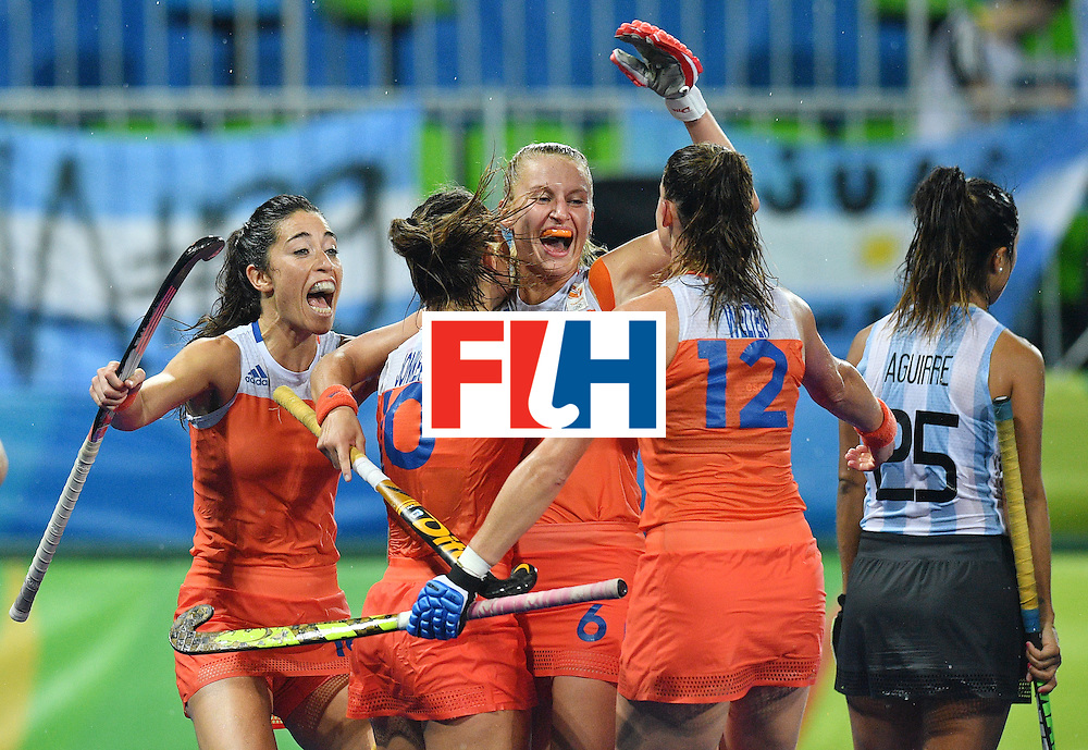 TOPSHOT - Netherland's Laurien Leurink (C) celebrates a goal with teammates during the women's quarterfinal field hockey Netherland vs Argentina match of the Rio 2016 Olympics Games at the Olympic Hockey Centre in Rio de Janeiro on August 15, 2016.  / AFP / Carl DE SOUZA        (Photo credit should read CARL DE SOUZA/AFP/Getty Images)