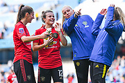 Manchester United Women midfielder Hayley Ladd (12) and Manchester United Women goalkeeper Emily Ramsey (13) after the match during the FA Women's Super League match between Manchester City Women and Manchester United Women at the Sport City Academy Stadium, Manchester, United Kingdom on 7 September 2019.