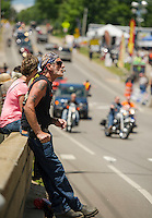 Sharon and Jim Lantagne of Haverhill, MA sat on the Channel Bridge watching bike traffic on Friday afternoon.  (Karen Bobotas/for the Laconia Daily Sun)
