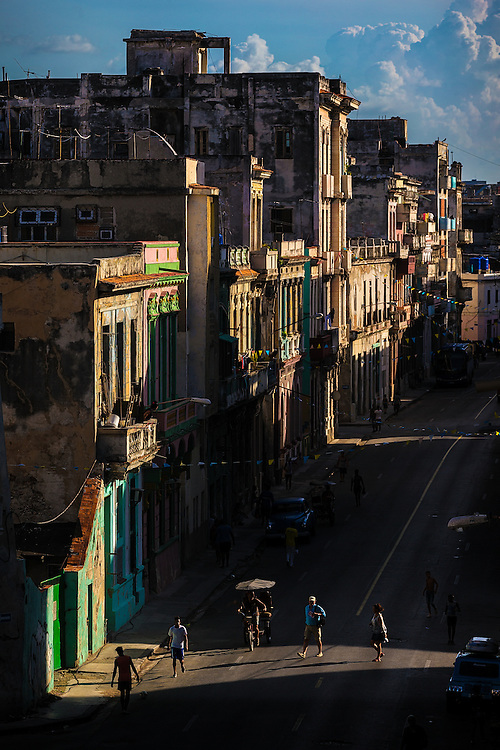 Patches of evening light illuminate street traffic in Central Havana, Cuba on July 11, 2015.