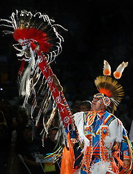 April 28, 2017 - Albuquerque, NM, U.S. - Terrance Goodwill of Saskatchewan, Canada carries the Eagle Staff for the Grand Entrance of the 2017 Gathering of Nations Pow-Pow held at Tingley Coliseum.   Friday April 28, 2017. (Credit Image: © Jim Thompson/Albuquerque Journal via ZUMA Wire)
