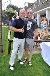 Left to right, SIMON KELNER and JAMES NESBITT at the Leuka Mini Masters Golf at Dukes Meadows, Chiswick, London on 15th July 2011.