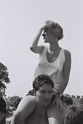 Girl on shoulders at Anti Apartheid concert, Clapham, UK, 1986.