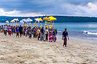 Bali, Badung, Jimbaran. A hindu ceremony held on the beach just before sunset.