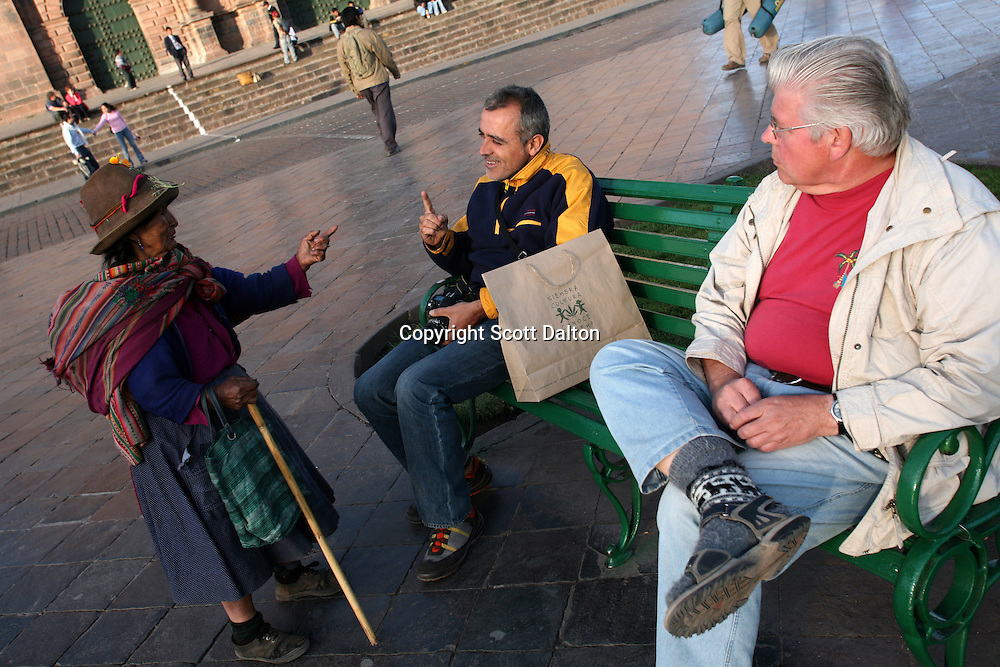 An Indian woman asks for money from a tourist in the Plaza de Armas in Cuzco, once the central city in the Inca empire, in Peru, on August 8, 2007. Now Cuzco serves as the gateway for visitors in route to lost Inca city of Machu Picchu that was recently voted one of the new Seven Wonders of the World. (Photo/Scott Dalton)