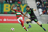 Maritimo´s player Eber Bessa (L ) fights for the ball with Sporting's player Palhinha   (R ) during Portuguese First League football match Maritimo vs Sporting held at Barreiros Stadium, Funchal, Portugal, 21 January, 2017.  EPA / GREGÓRIO CUNHA