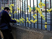 """Messages of hope are tied to a fence in New York City days after the Sept. 11th attack on The World Trade Center. Through my eyes and with my camera I am able to see the world we live in, and try to bring things into focus. Photography preserves my vision of what """"I see"""" at a specific time and place- a moment. Creating a bond between  me and my subject and capturing and emotion for eternity. Having lived and worked in New York City for over 15 years when 911 happened. I had to go and """"see"""" with my camera what lower Manhattan was like after this horrific attack on our Nation. The World Trade Center owned the skyline in lower Manhattan making it feel more like a canyon. After the Twin Towers fell, and I saw with my own eyes and camera the destruction, I realized what little land they actually sat on. The Twin Towers may not have occupied a large plot of land but they now touched everyones life. Photo©SuziAltman"""