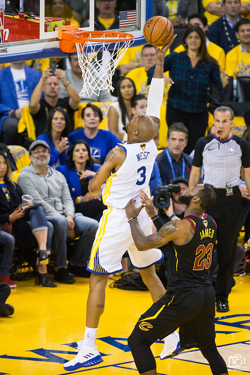 Golden State Warriors forward David West (3) lays the ball into the basket against the Cleveland Cavaliers during Game 1 of the NBA Finals at Oracle Arena in Oakland, Calif., on May 31, 2018. (Stan Olszewski/Special to S.F. Examiner)