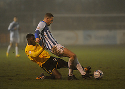 Bristol Rovers' Nathan Blissett  challenges Nuneaton Town's Gavin Cowan - Photo mandatory by-line: Neil Brookman/JMP - Mobile: 07966 386802 - 04/01/2015 - SPORT - football - Nuneaton - James Parnell Stadium - Nuneaton Town v Bristol Rovers - Vanarama Conference