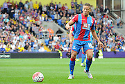 Dwight Gayle plays a wide ball during the Barclays Premier League match between Crystal Palace and Manchester City at Selhurst Park, London, England on 12 September 2015. Photo by Michael Hulf.
