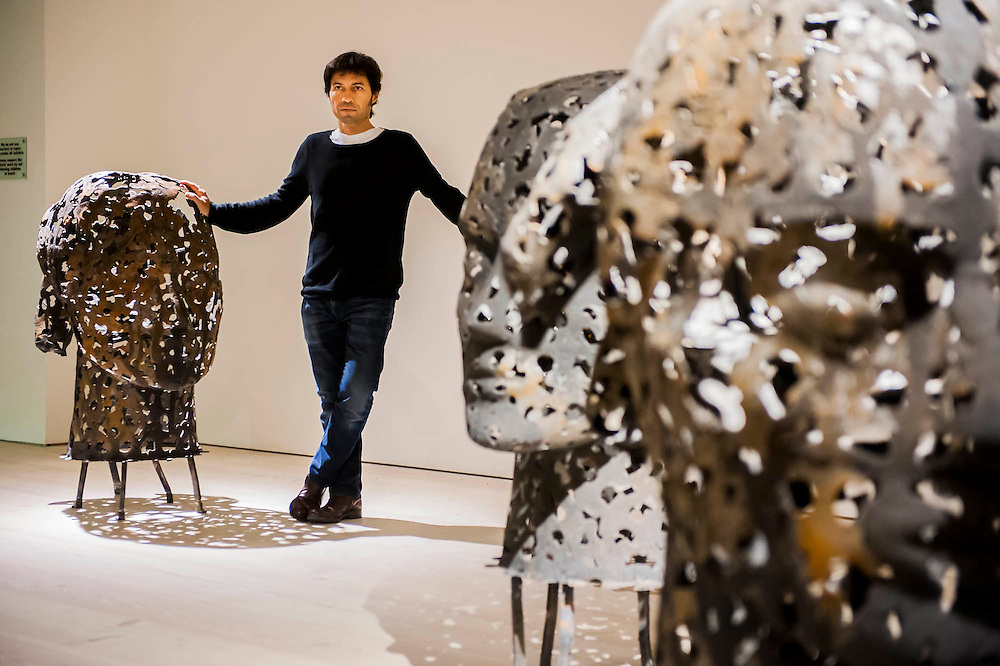 """Departure, the first UK solo exhibition of artist Xavier Mascaró. Highlights include: an installation of boats made from bronze and iron """"which are evocative of long-forgotten shipwrecks""""; iron portraits of a young woman from the Eleonora series """"reminiscent of the profiles on ancient coins""""; delicate metal works """"resembling votive figures from his Idols series""""; and his Guardians series, of 10 feet high rusted iron warriors """"inspired by medieval armour and ancient Egyptian and Greek art"""".  The latter being the first outdoor installation by the Gallery since moving to Chelsea. The show runs from 3 September until 5th October at The Saatchi Gallery, Chelsea, London. 01 September 2014."""