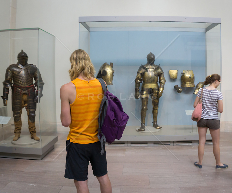 people at The Metropolitan Museum of Art looking at armor.
