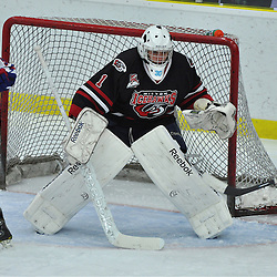 COBOURG, ON - Oct 12 : Ontario Junior League Game Action between, Milton Icehawk's Hockey Club and the North York Ranger's Hockey Club at the OJHL Governors Showcase Tournament. #1 Justin Urquhart goaltender of the Milton Icehawks protects the crease during third period game action..(Photo by Jennifer-Rose DeVincentis / OJHL Images