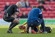 Darren Drysdale (Referee) checks on how Jim O'Brien (Scunthorpe United) is following a challenge during Barnsley v Scunthorpe United at Oakwell, Barnsley, England on 25 March 2016. Photo by Mark P Doherty.