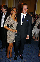 "JOEL CADBURY and DIVIA LALVANI at a party to celebrate the publication of Bruce Oldfield's autobiography ""Rootless"" held in aid of Crimestoppers at Claridge's, Brook Street, London W1 on 22nd September 2004.<br />
