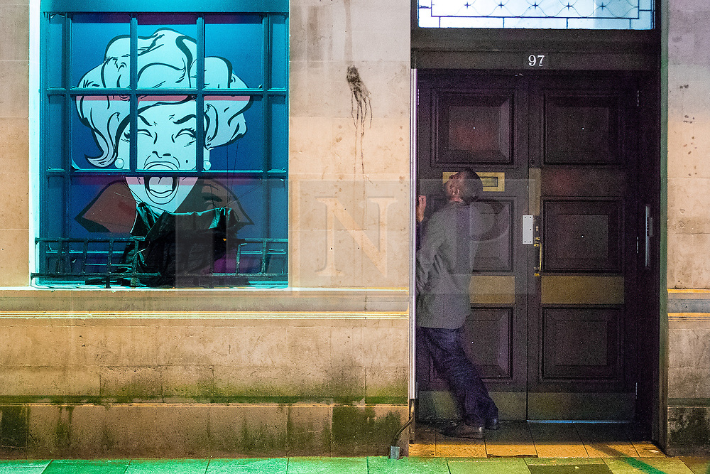 © Licensed to London News Pictures . 17/03/2017 . Cardiff , UK. A man urinates in a doorway on St Mary Street . Revellers on a windy and wet Saint Patrick's Day night out in Cardiff city Centre . Photo credit: Joel Goodman/LNP